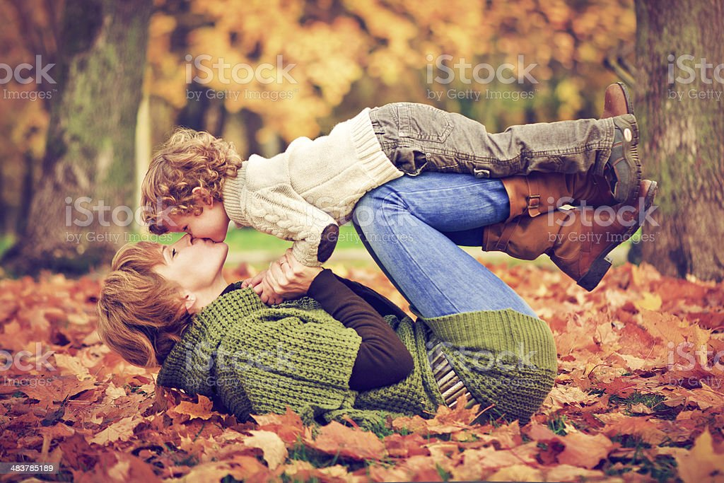 Mother and son in autumn royalty-free stock photo
