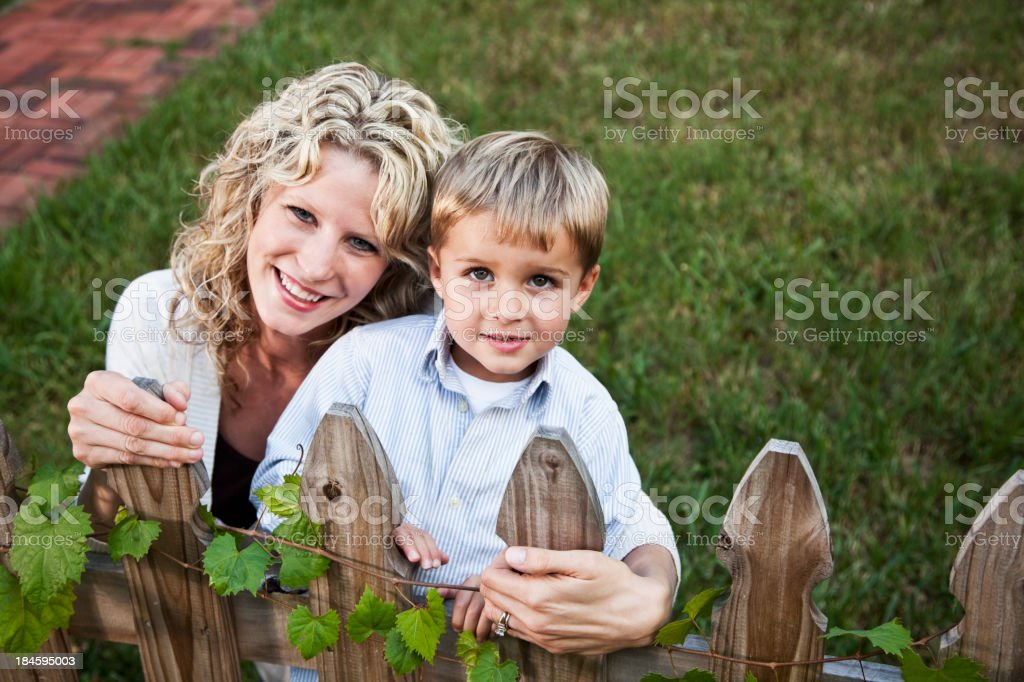 Mother and son in back yard stock photo