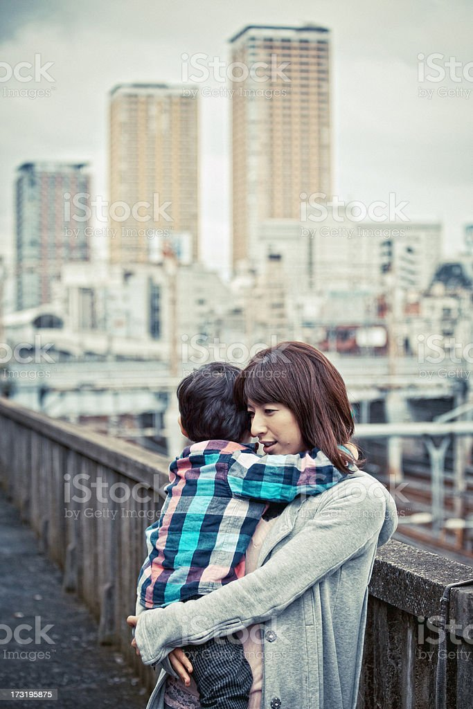 mother and son in big city royalty-free stock photo
