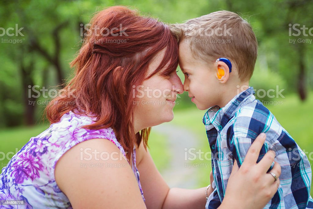 Mother and son in forest having fun stock photo