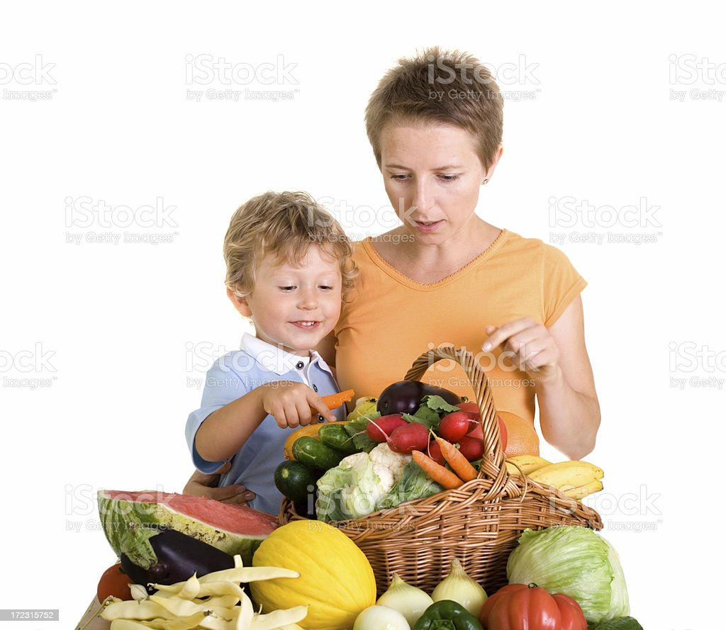 mother and son in front of healthy eating royalty-free stock photo