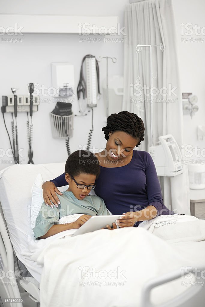 Mother and son in hospital royalty-free stock photo