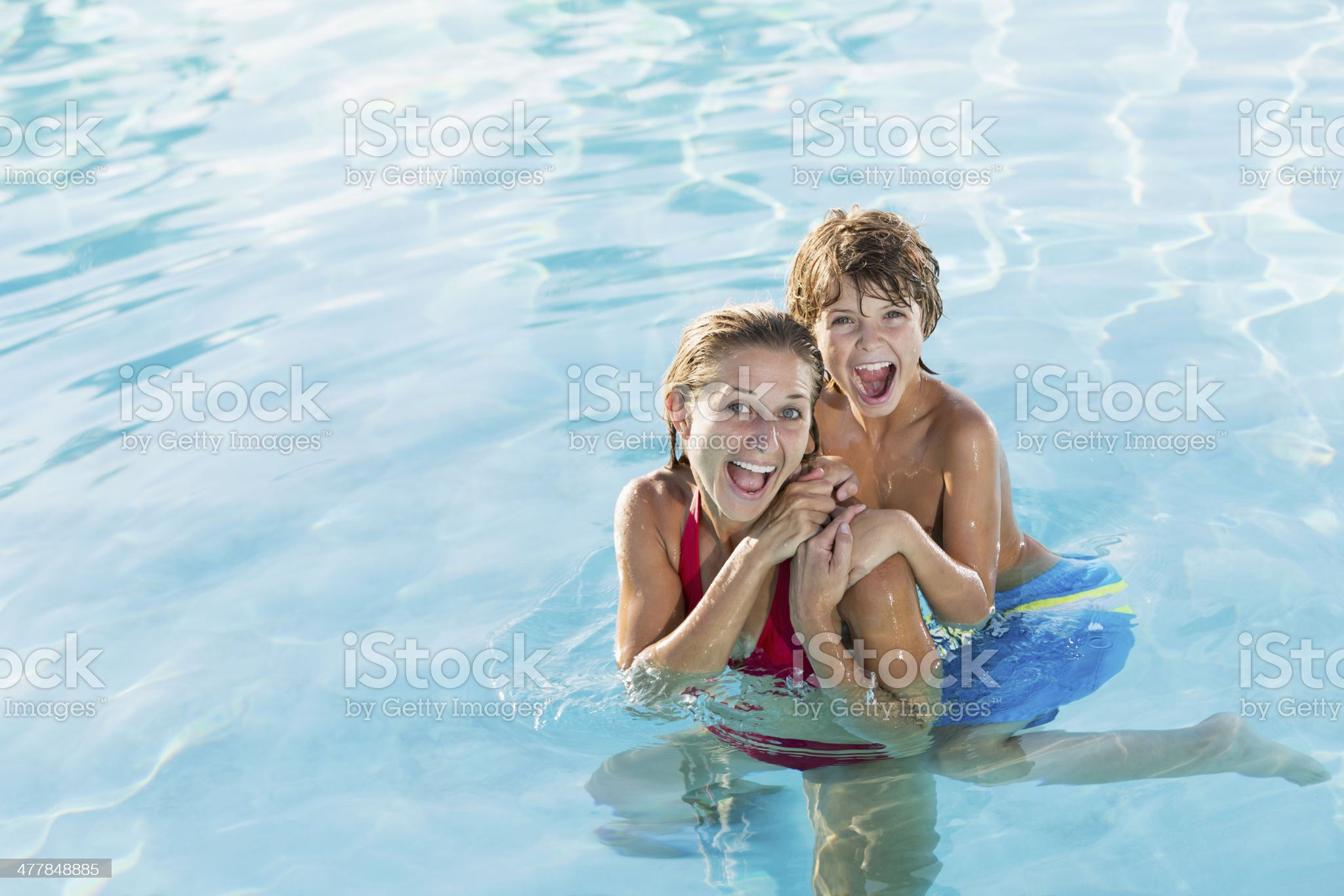 Mother and son in pool royalty-free stock photo