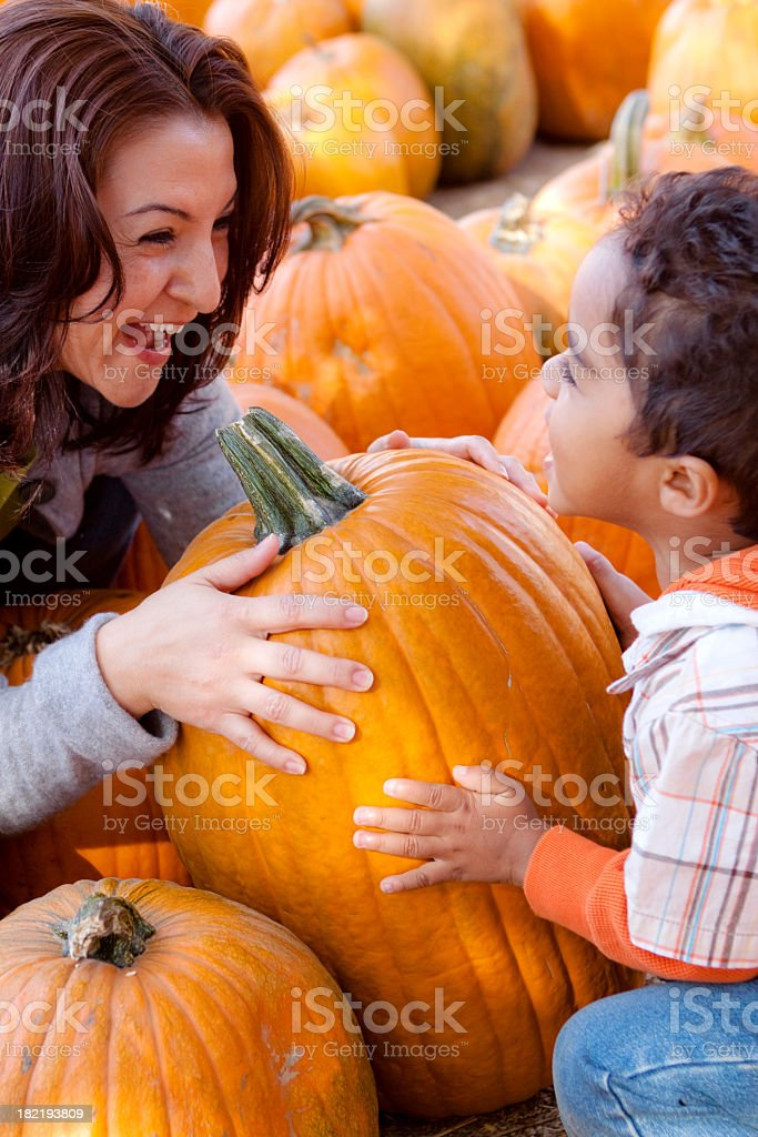 Mother and Son in Pumpkin Patch stock photo