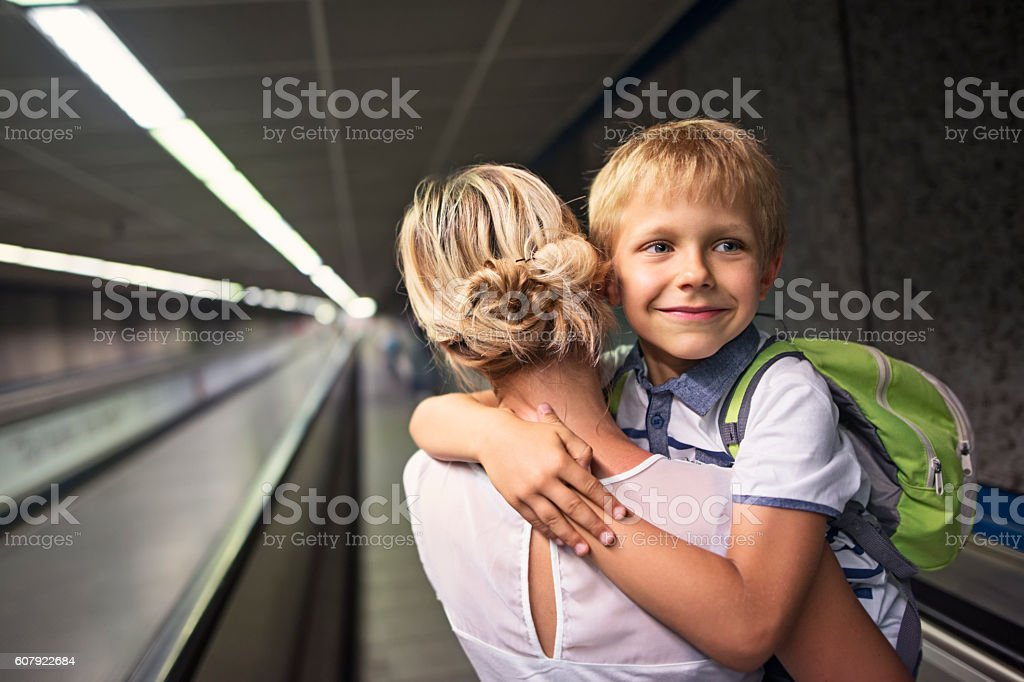 Mother and son in Rome metro moving walkway stock photo