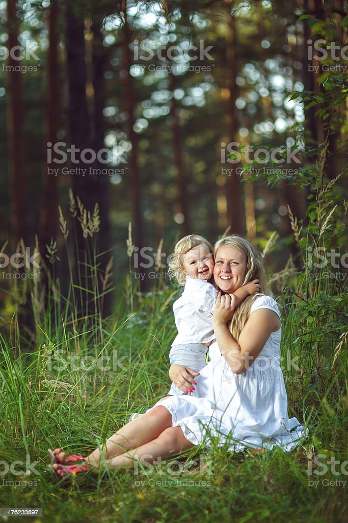 Mother and son in the forest royalty-free stock photo