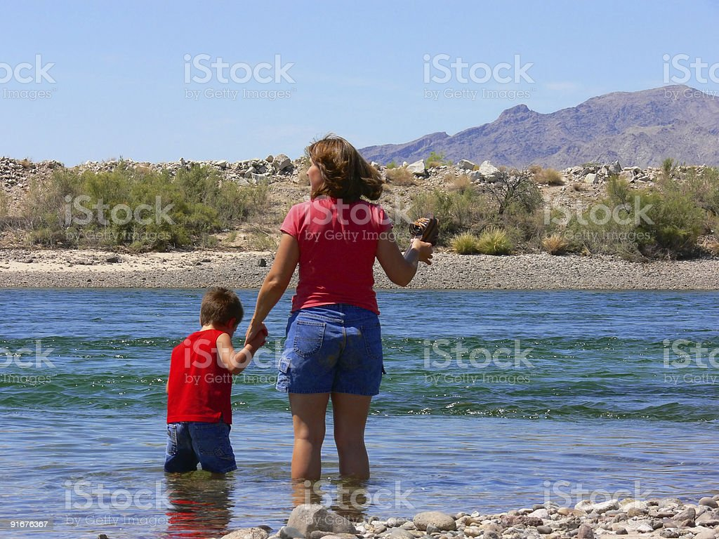 Mother and son in the river stock photo