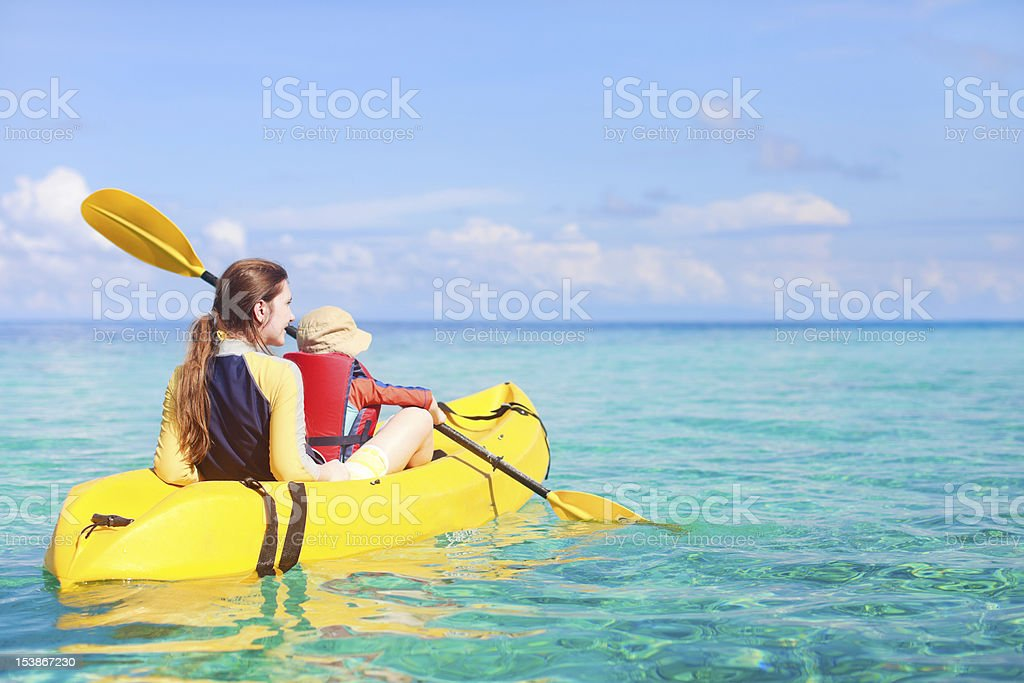 Mother and son kayaking in the ocean royalty-free stock photo