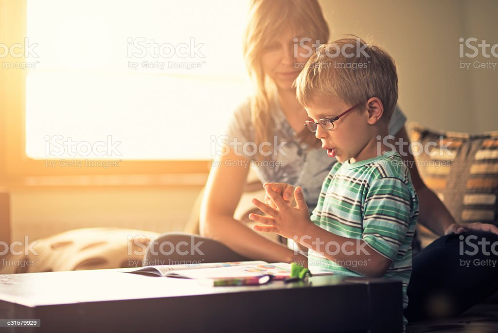 Mother and son learning to count stock photo