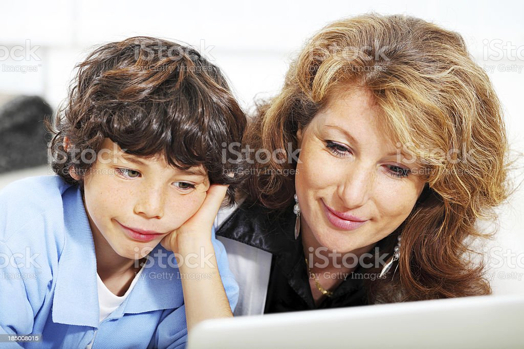 Mother and son learning to use a laptop royalty-free stock photo