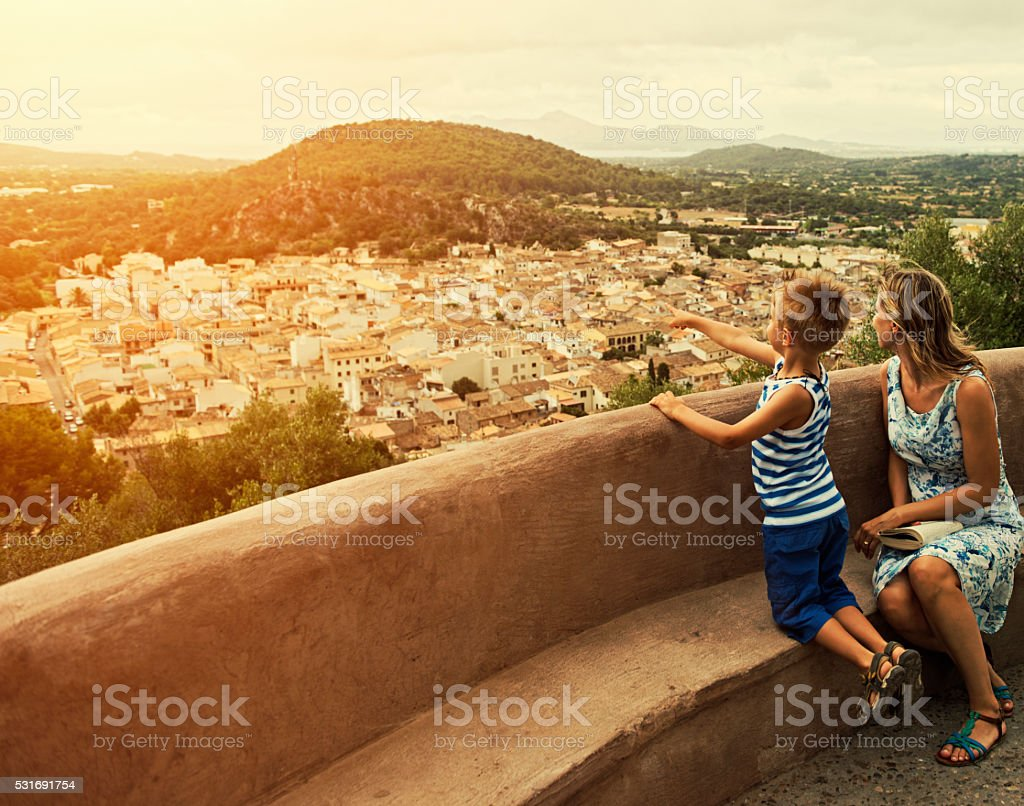 Mother and son looking at mediterranean view of Mallorca town stock photo