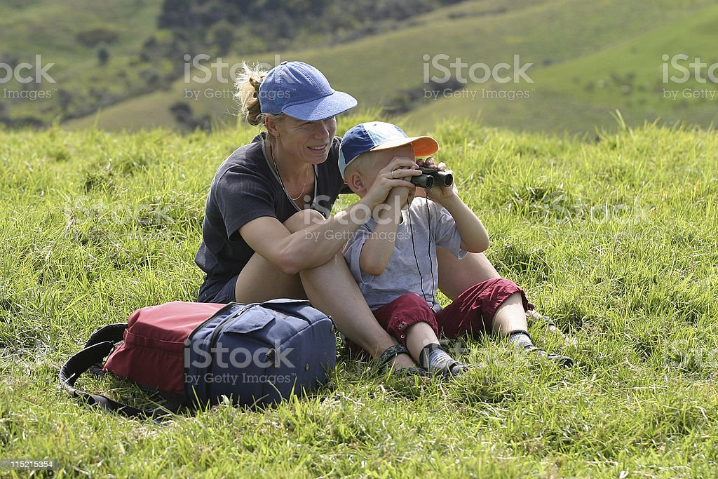 Mother and son looking through binoculars royalty-free stock photo