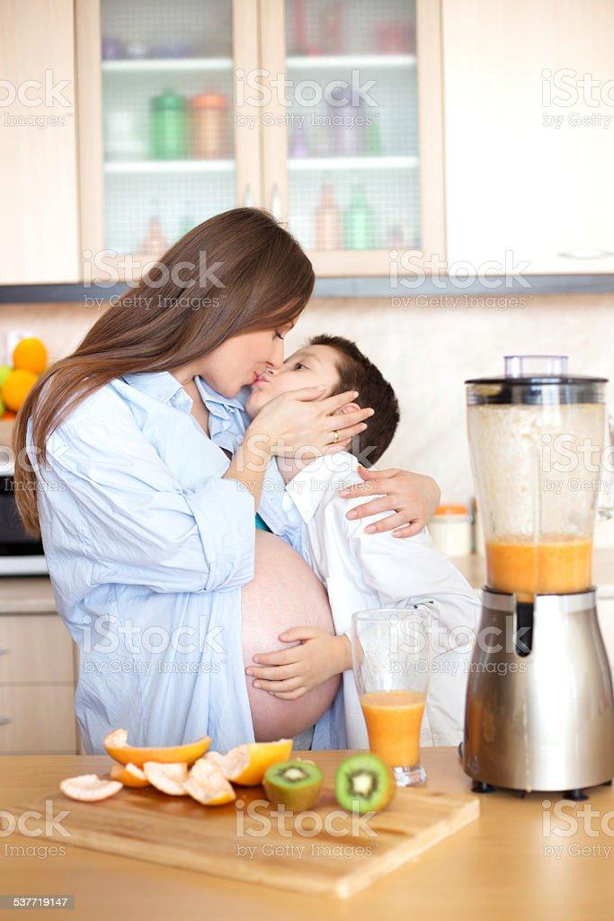 Mother and son making fresh orange juice stock photo