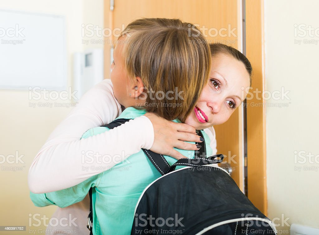 Mother and son near door stock photo