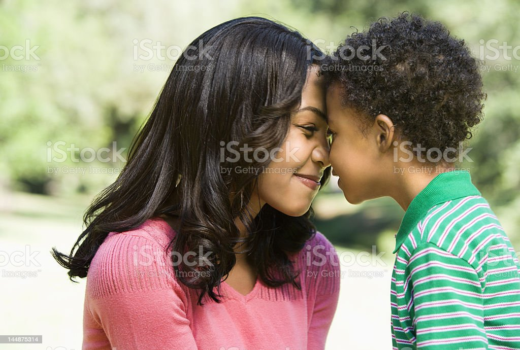 Mother and son nuzzling. stock photo