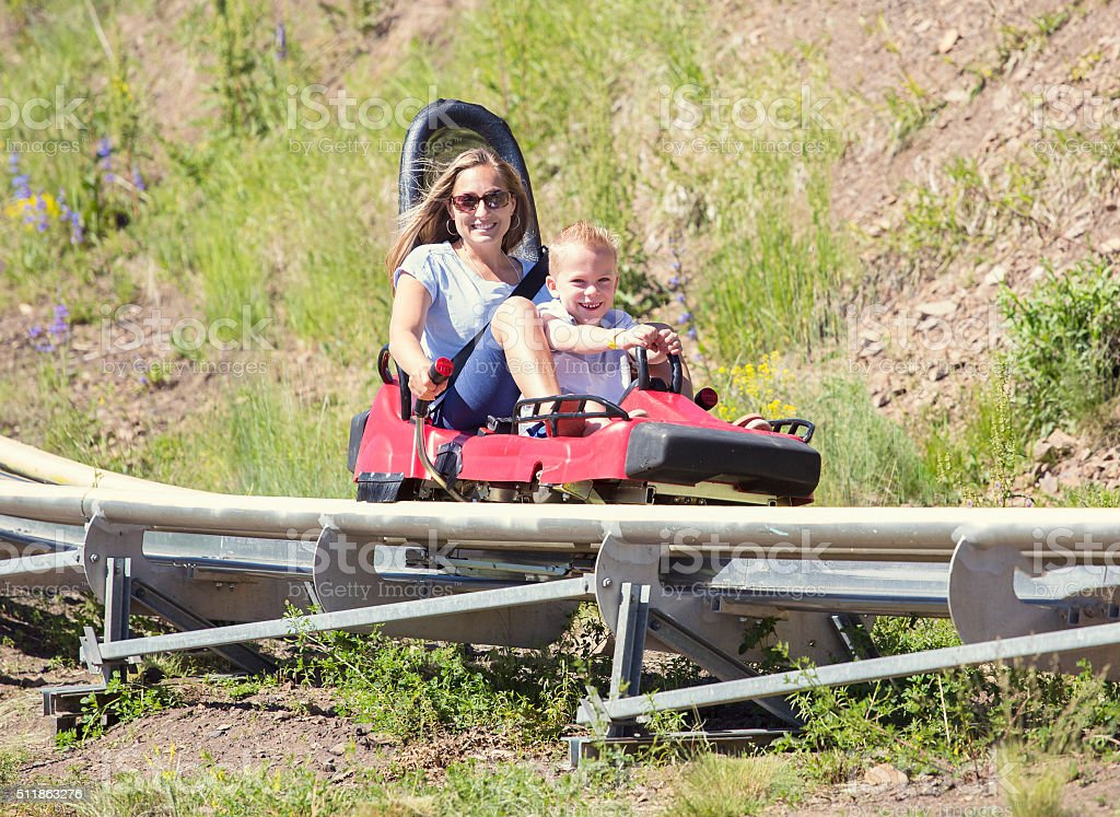 Mother and son on a fun roller coaster ride stock photo
