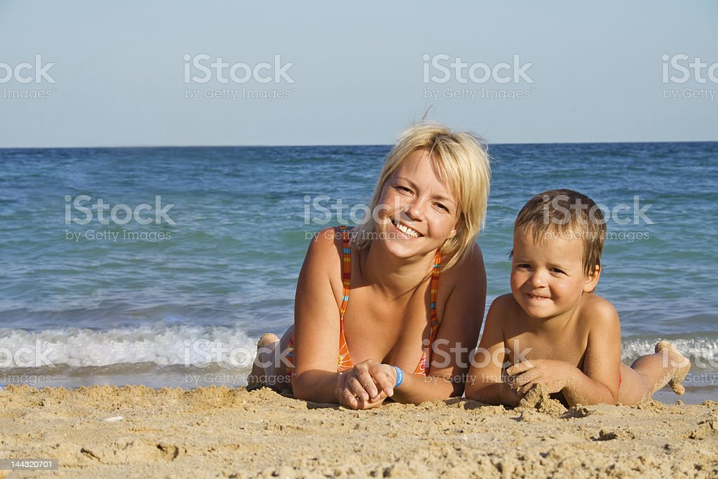 Mother and son on the beach royalty-free stock photo