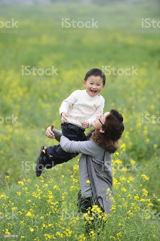 mother and son outdoor in flowers royalty-free stock photo