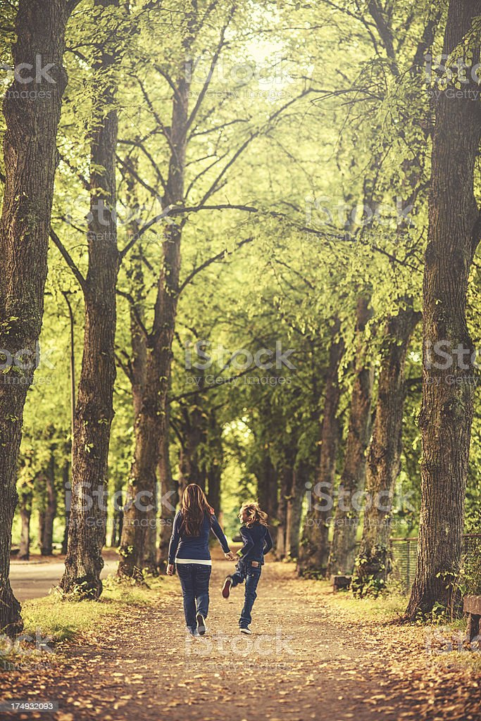 Mother and son outdoors on a walk stock photo