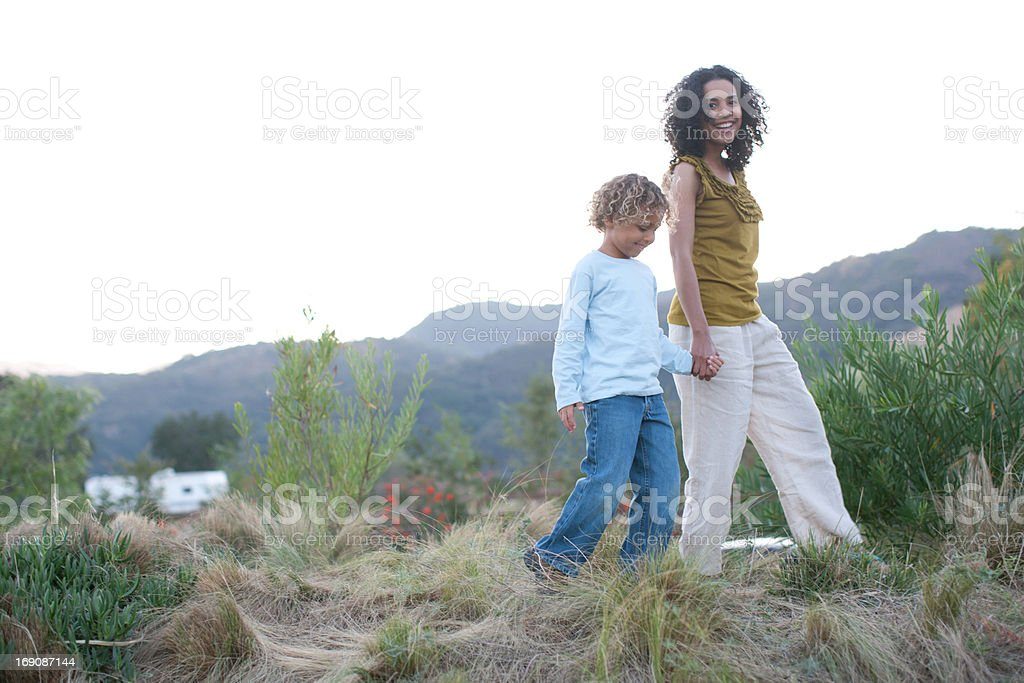 Mother and son outdoors stock photo