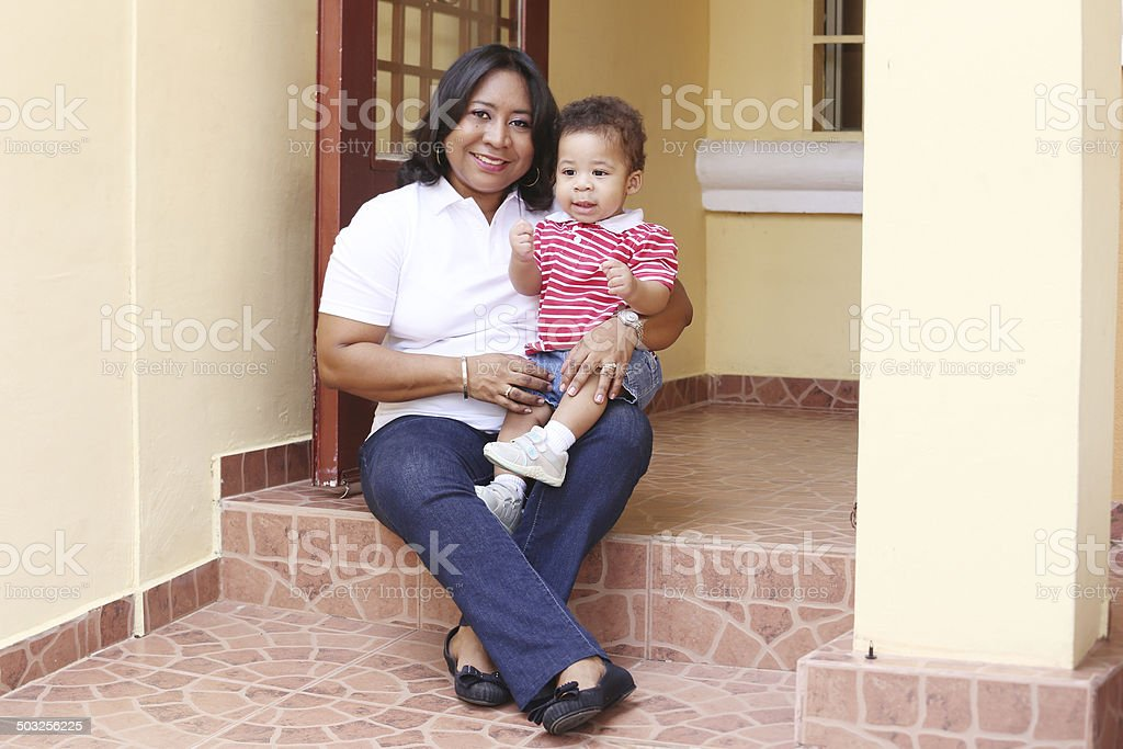 Mother and son outside of their new house. stock photo