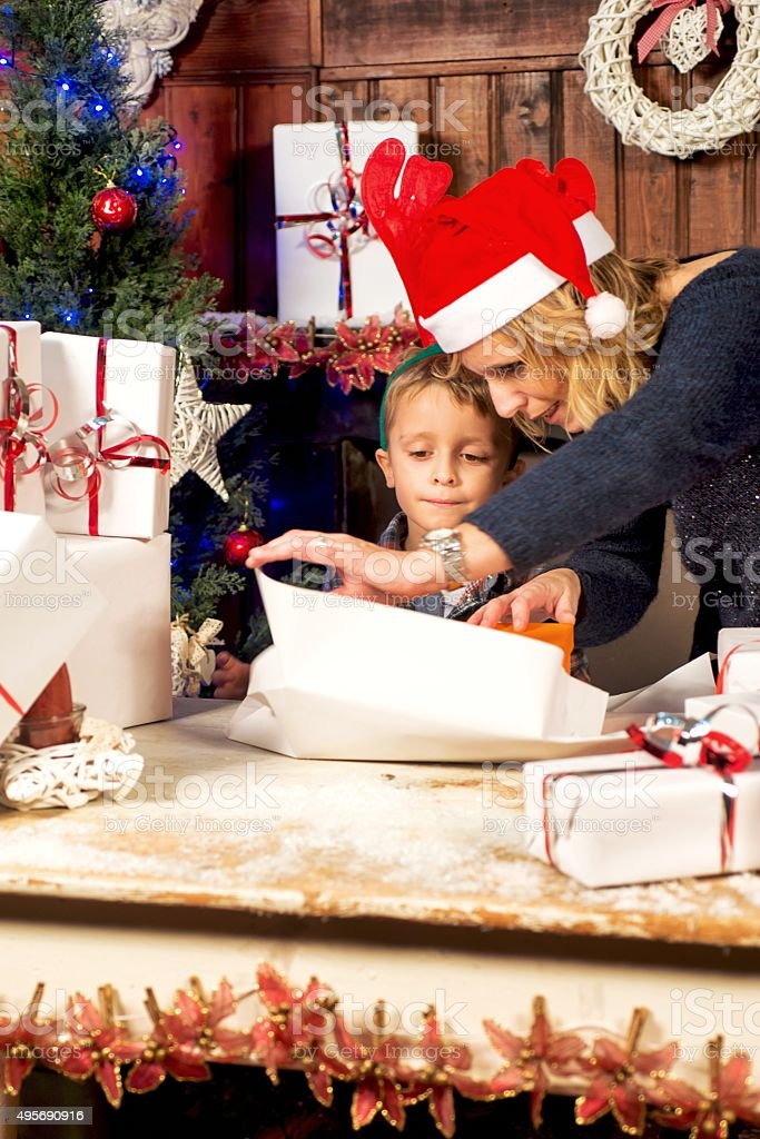 Mother and Son Packing Christmas Boxes stock photo