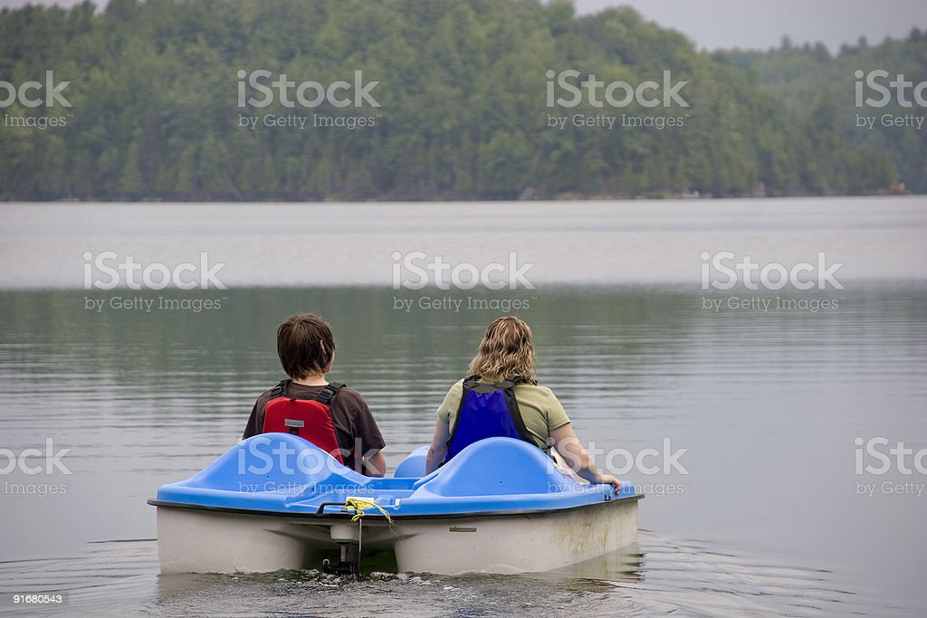 Mother and son paddleboating royalty-free stock photo