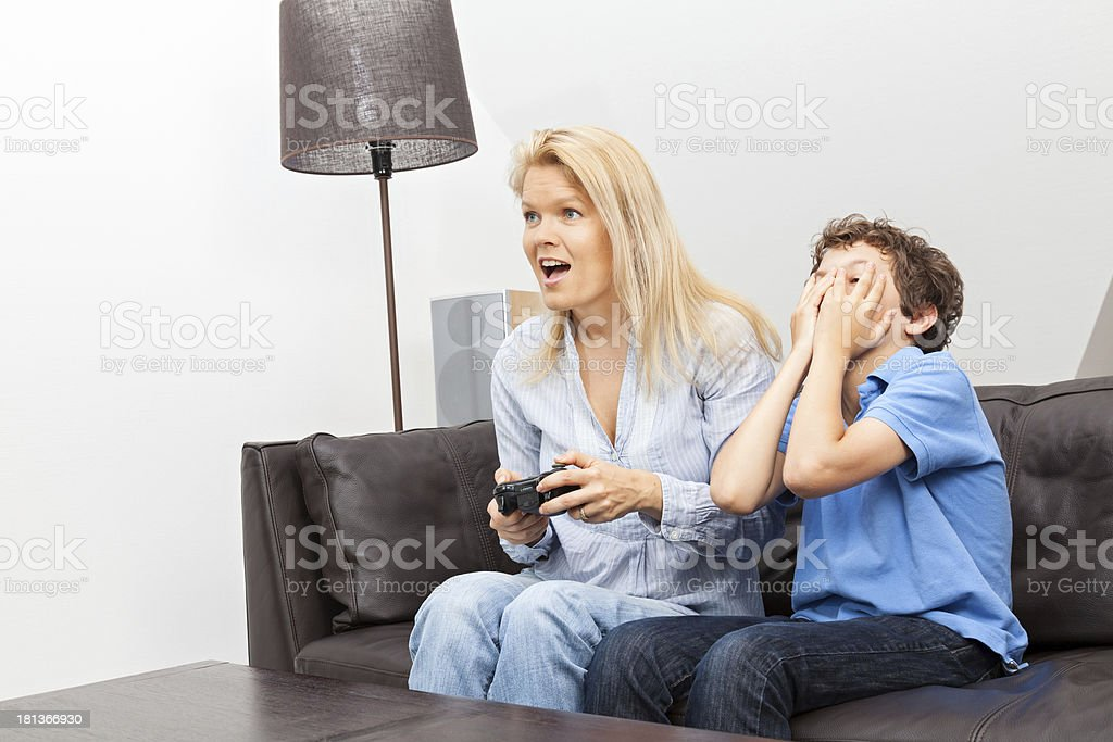Mother and son playing a video game royalty-free stock photo