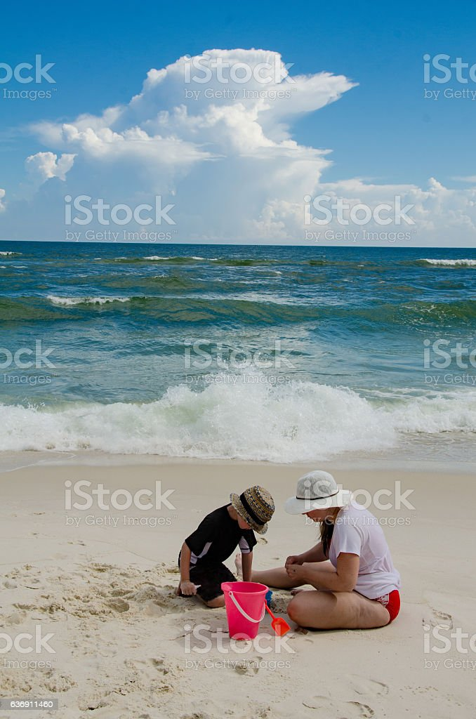 Mother and Son Playing in Sand stock photo