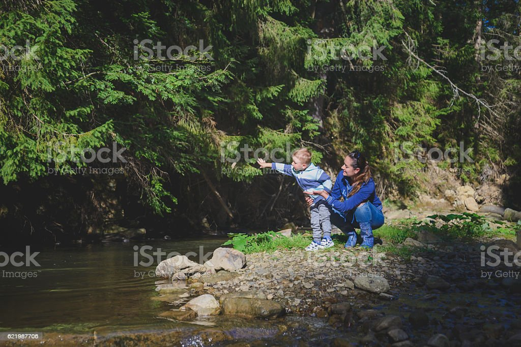 Mother and son playing in the river stock photo