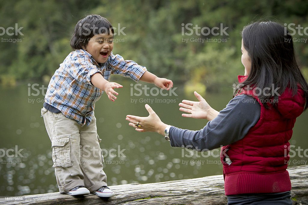 Mother and son playing outside. royalty-free stock photo