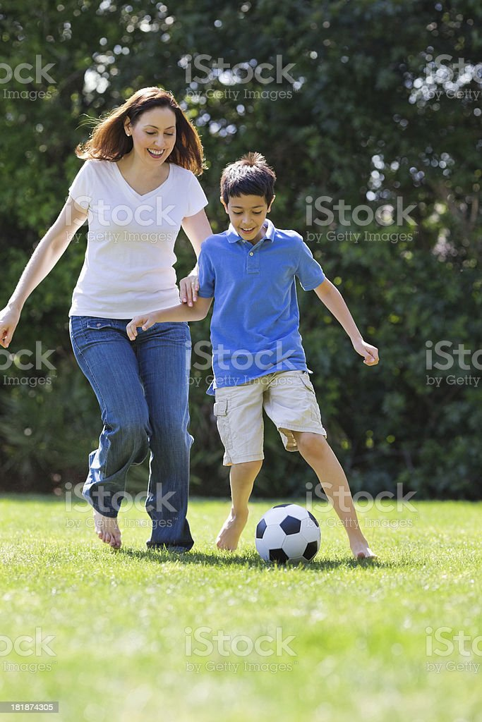Mother And Son Playing Soccer royalty-free stock photo