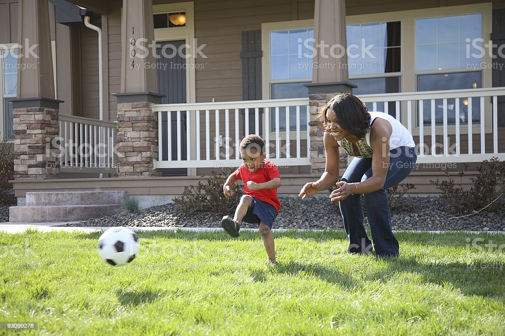 Mother and son playing soccer stock photo