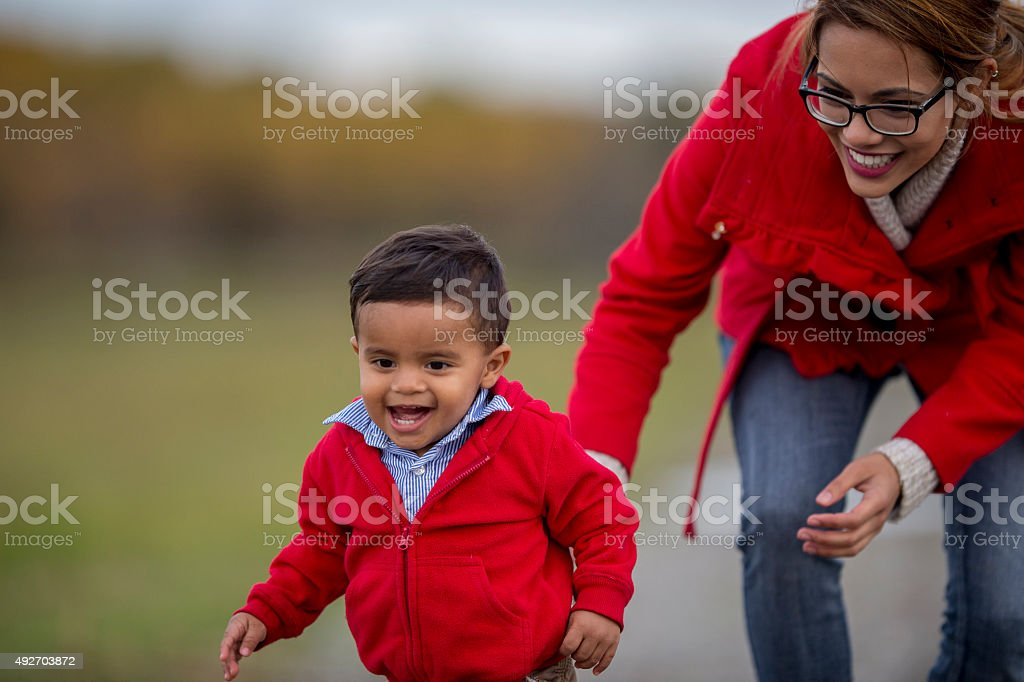 Mother and Son Playing Together Outside stock photo
