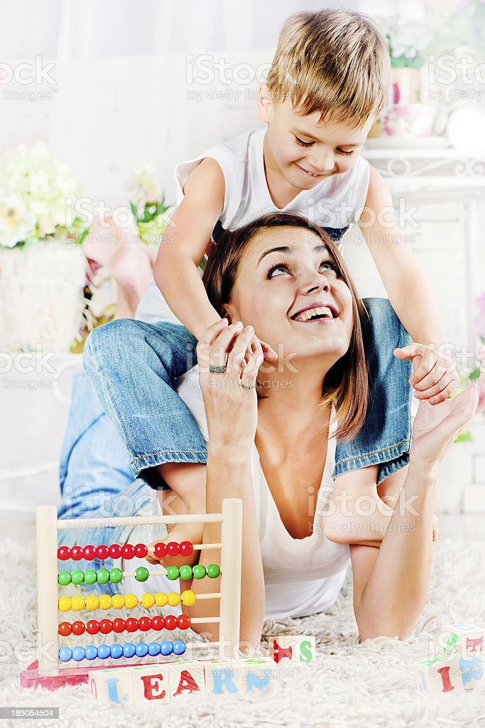 Mother and son playing together royalty-free stock photo