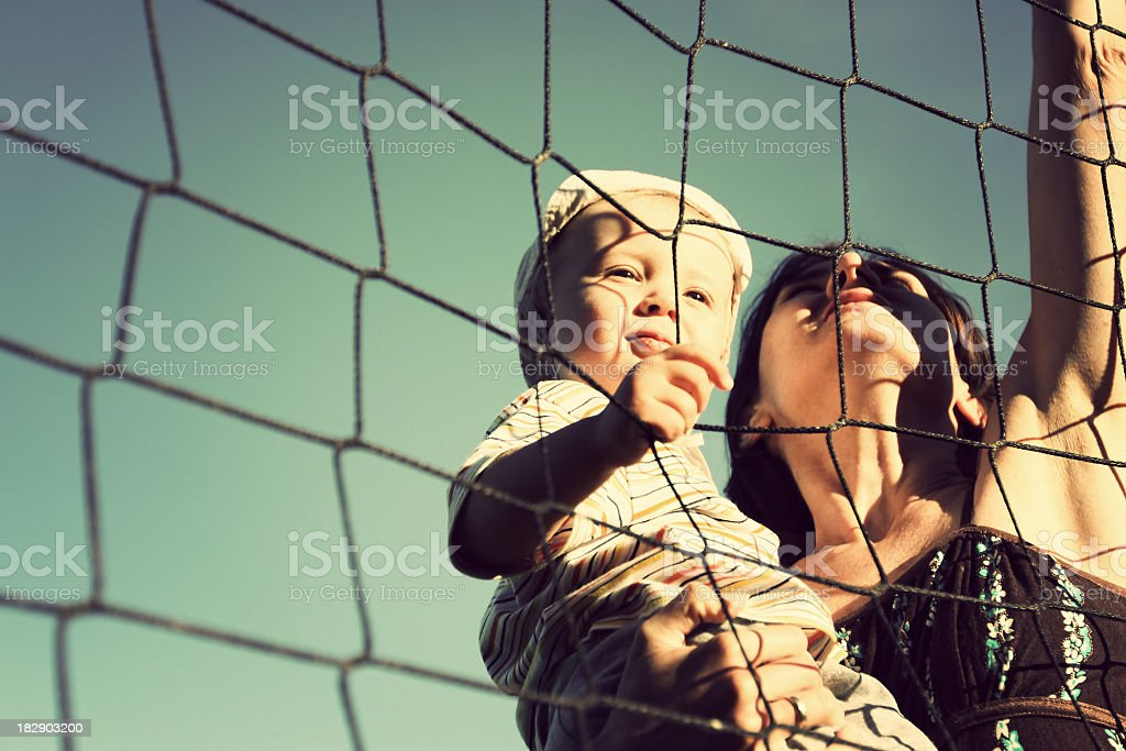 Mother and son playing volleyball royalty-free stock photo