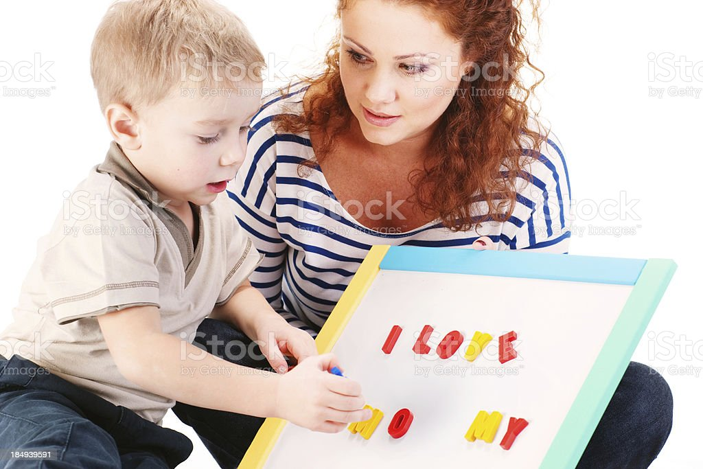 Mother and son playing with magnet board stock photo