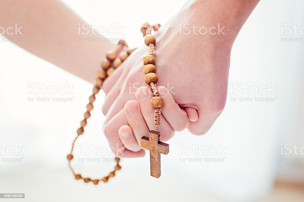 Mother and son praying together stock photo