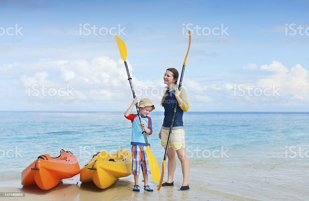 Mother and son preparing for kayaking royalty-free stock photo