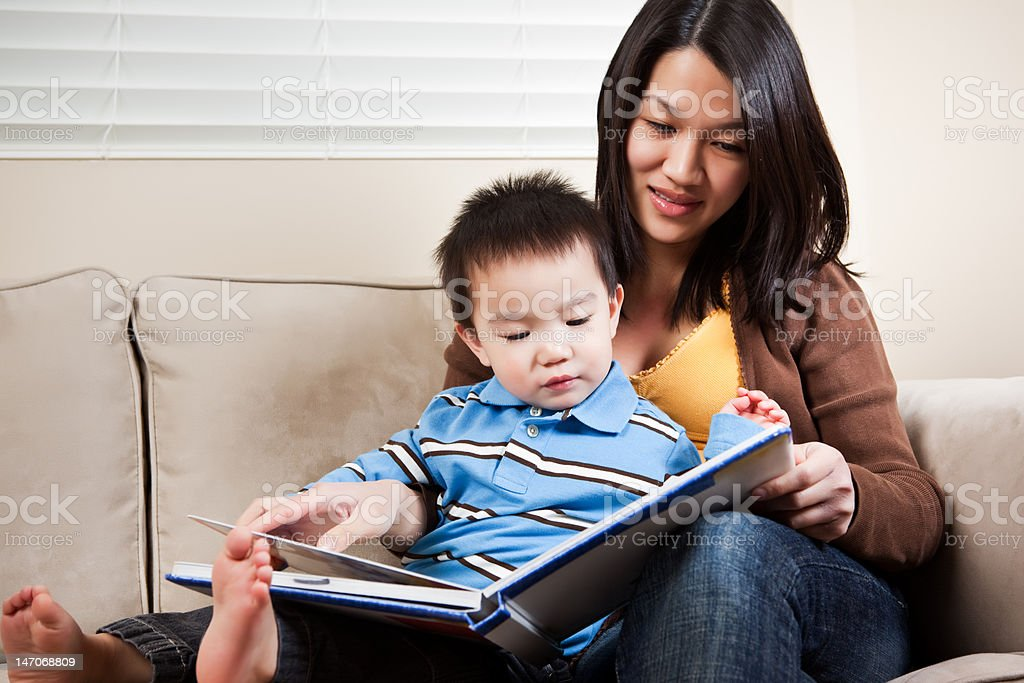 Mother and son reading royalty-free stock photo