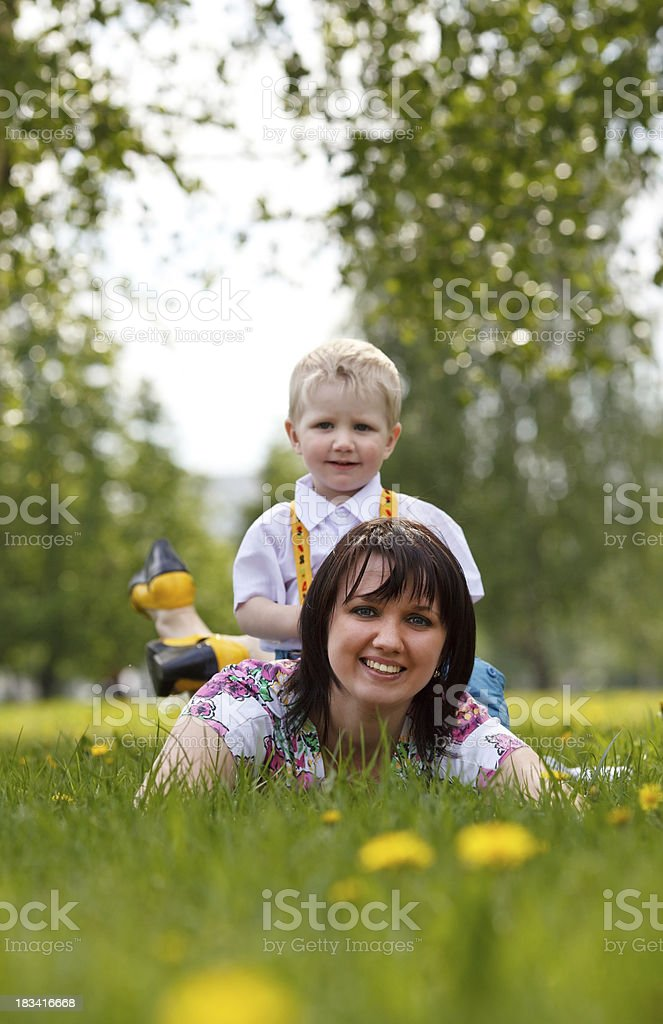 Mother and son relaxing outdoors royalty-free stock photo