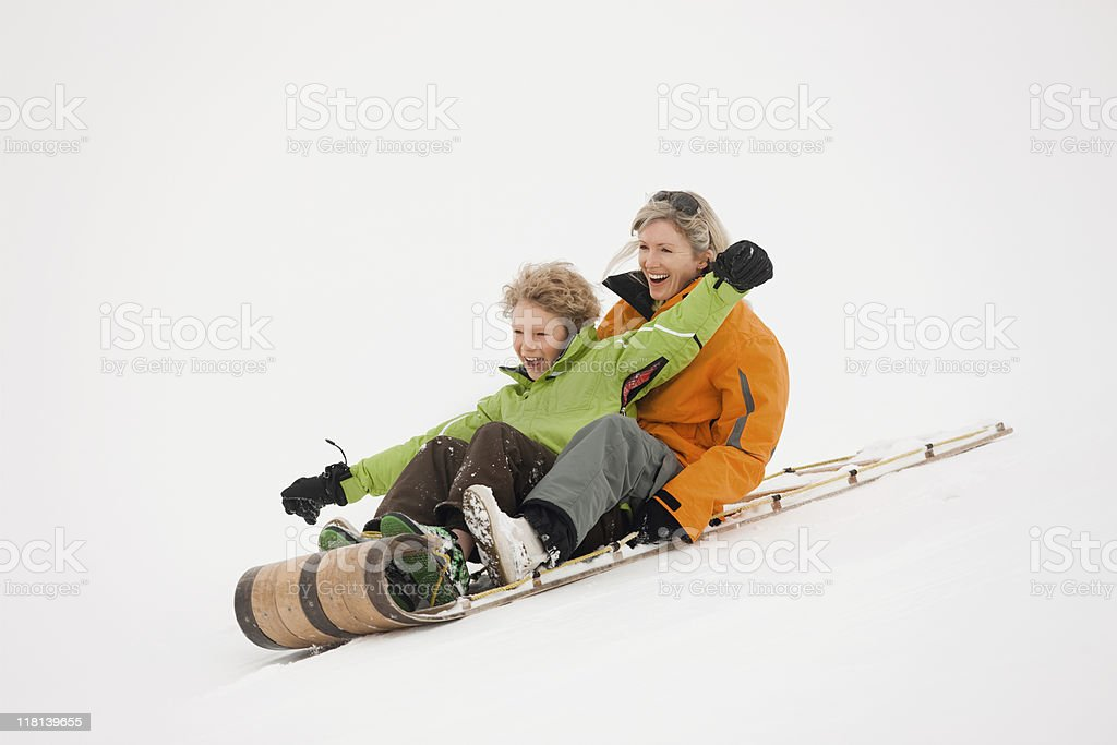 Mother and Son Riding On A Sled royalty-free stock photo