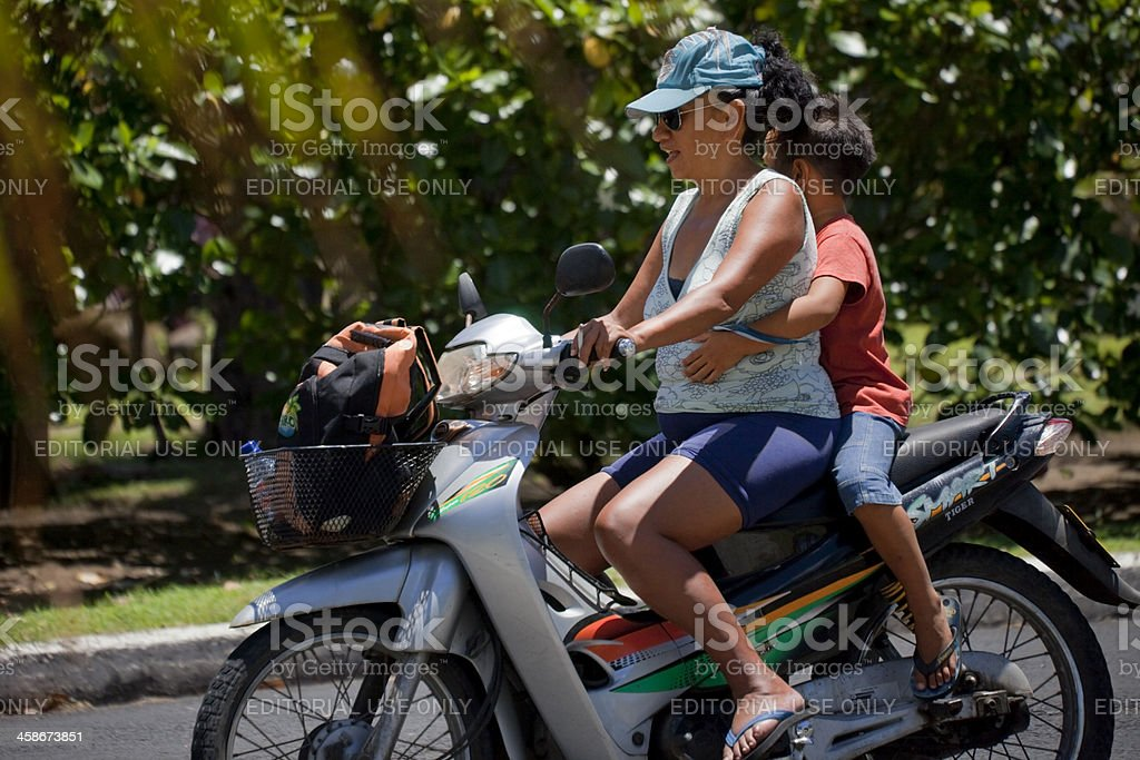Mother and Son Riding Tiger Smart motorcycle royalty-free stock photo