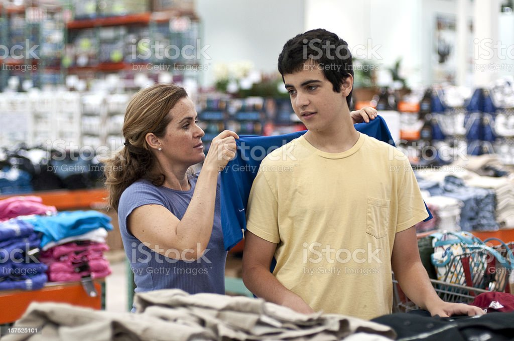 Mother and son shopping for clothes royalty-free stock photo