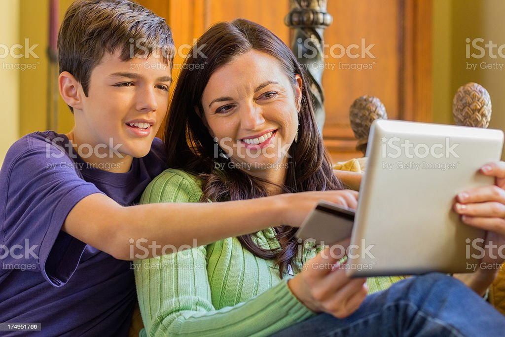 Mother And Son Shopping Online royalty-free stock photo