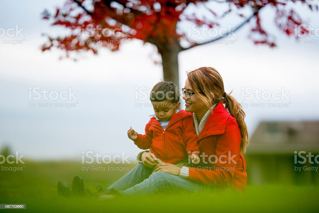 Mother and Son Sitting Together Outside stock photo