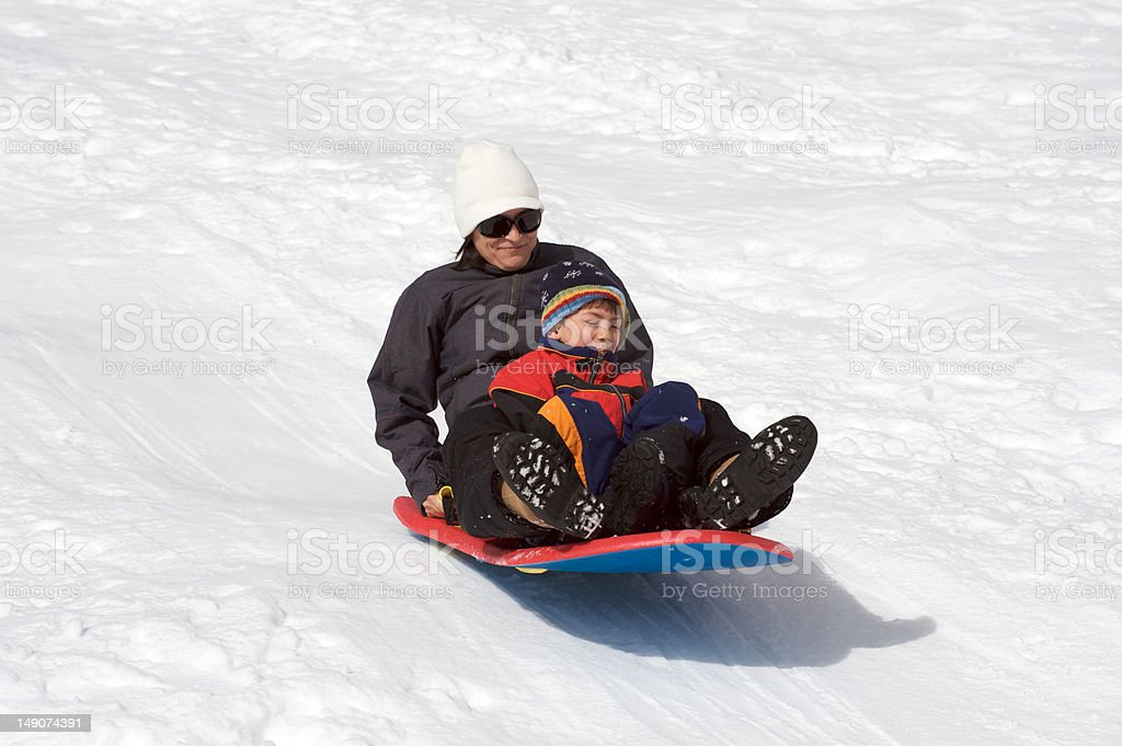 Mother and son sledding royalty-free stock photo
