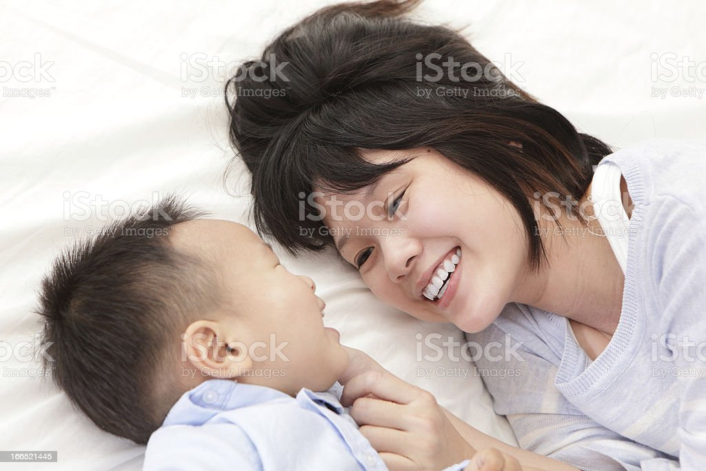 Mother and son smile look each other royalty-free stock photo