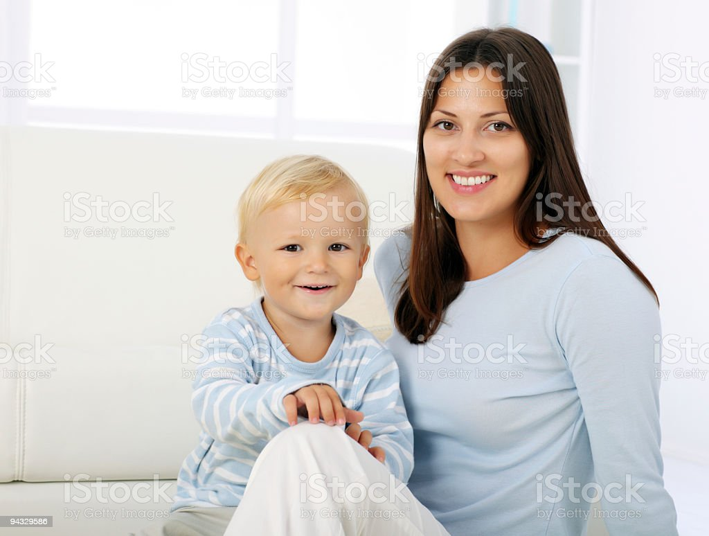 Mother and son smiling while looking at camera. royalty-free stock photo