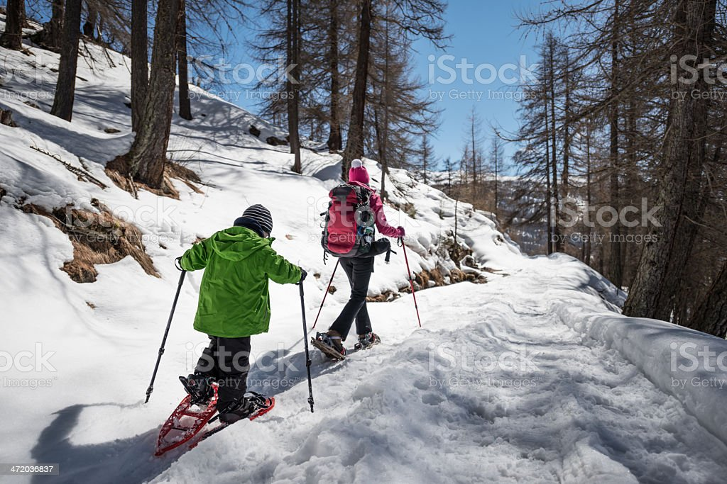 Mother and Son Snowshoeing stock photo